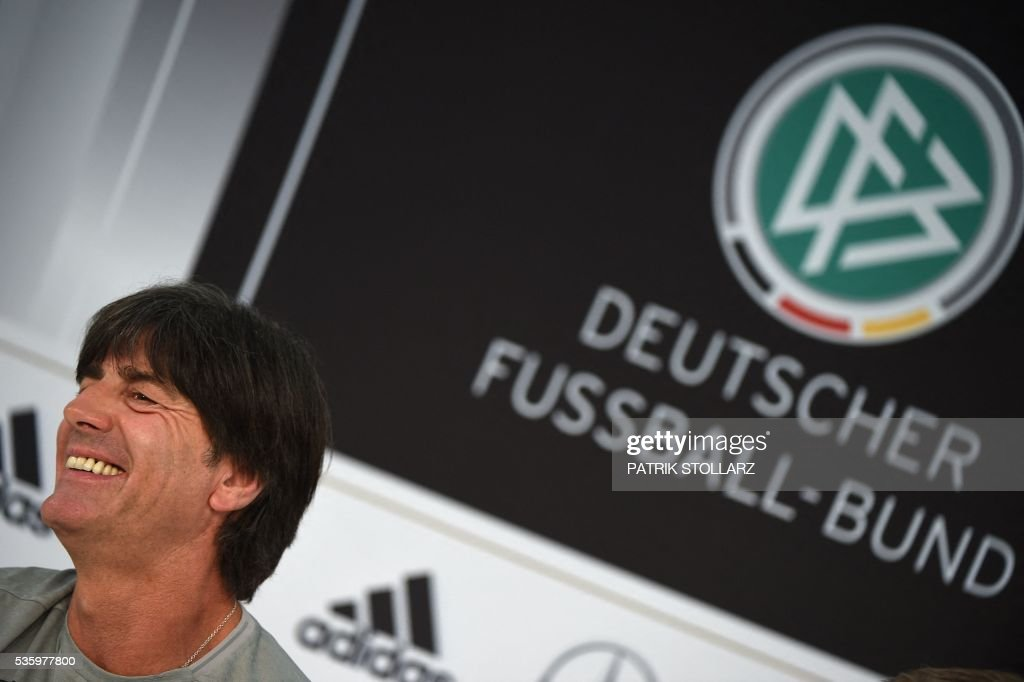Germany's head coach Joachim Loew smiles during a press conference on the sideline of the team's preparation for the upcoming Euro 2016 European football championships, on May 31, 2016 in Ascona. / AFP / PATRIK