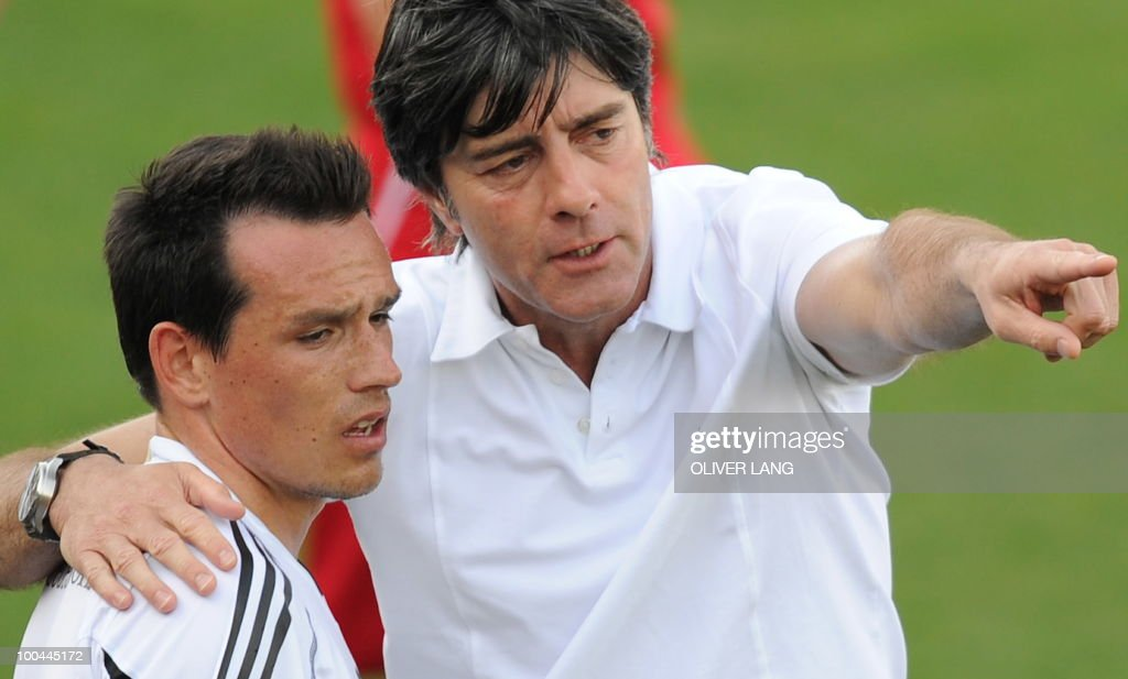 Germany's head coach Joachim Loew (R) talks with midfielder Piotr Trochowski during a training match Germany vs Sued Tyrol FC at the team's training centre in Appiano, near the north Italian city of Bolzano May 24, 2010. The German football team is currently taking part in a 12-day training camp in Appiano to prepare for the upcoming FIFA Football World Cup in South Africa.