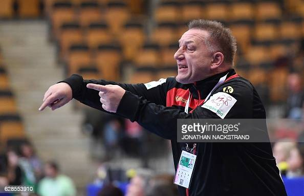 Germany's head coach Michael Biegler reacts during the Women's European Handball Championship Group B match between Germany and Poland in...