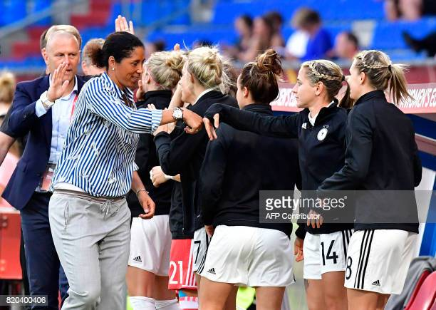 Germany's head coach Steffi Jones celebrates with players after Germany scored during the UEFA Women's Euro 2017 football match between Germany and...