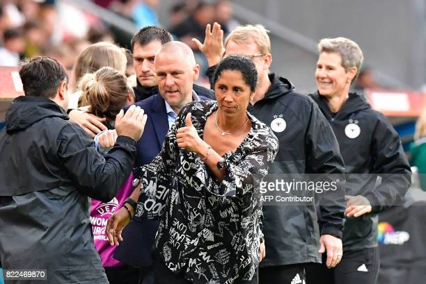Germany's head coach Steffi Jones reacts after Germany scored during the UEFA Women's Euro 2017 football match between Russia and Germany at...