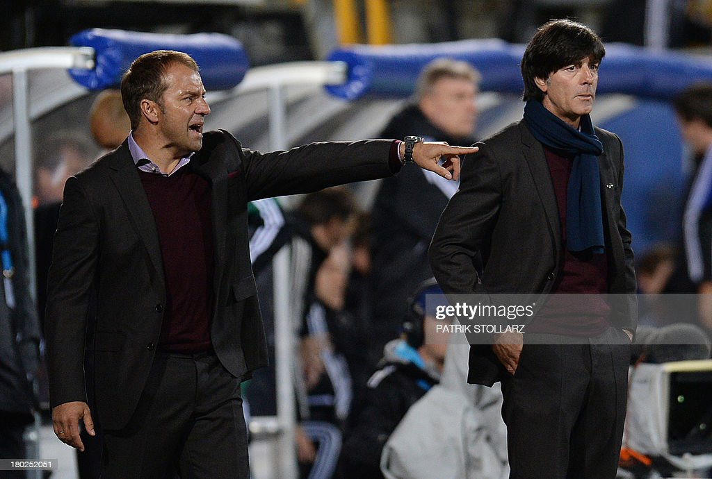 Germany's headcoach <a gi-track='captionPersonalityLinkClicked' href=/galleries/search?phrase=Joachim+Loew&family=editorial&specificpeople=215315 ng-click='$event.stopPropagation()'>Joachim Loew</a> (R) and assitant coach Hansi Flick react during the FIFA World Cup 2014 qualifying football match Faroe Island vs Germany in Torshavn on September 10, 2013. AFP PHOTO / PATRIK STOLLARZ