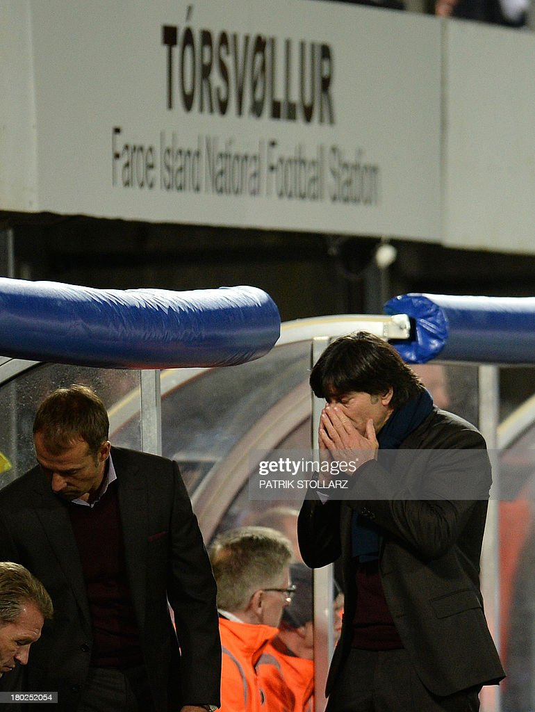 Germany's headcoach Joachim Loew (R) and assitant coach Hansi Flick react during the FIFA World Cup 2014 qualifying football match Faroe Island vs Germany in Torshavn on September 10, 2013.