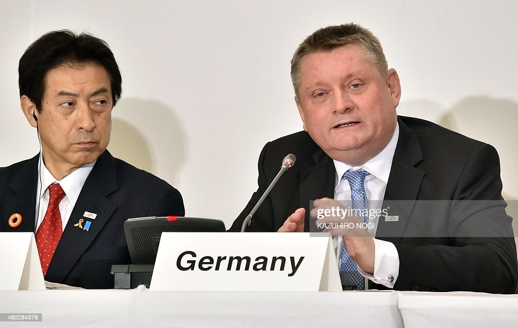 Germany's Health Minister Hermann Grohe (R) speaks as Japan's Health Minister <a gi-track='captionPersonalityLinkClicked' href=/galleries/search?phrase=Yasuhisa+Shiozaki&family=editorial&specificpeople=642749 ng-click='$event.stopPropagation()'>Yasuhisa Shiozaki</a> (L) looks on during a press conference for the 15th Global Health Security Initiative Ministerial Meeting in Tokyo on December 11, 2014. Health ministers, secretaries and commissioners from the European Commission, France, Germany, Italy, Japan, Mexico, Britain, the US and observer WHO, discussed key priorities for a collective preparedness and response to chemical, biological, radiological and nuclear (CBRN) threats, pandemic influenza and other emerging infectious diseases, specifically the Ebola outbreak in West Africa.