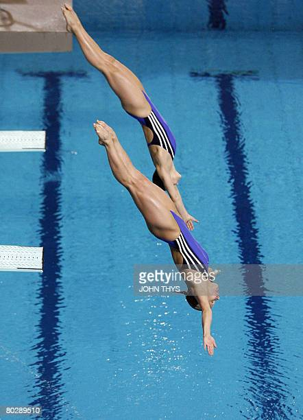 Germany's Heike Fisher and Ditte Kotzian dive during the women's 3m synchro springboard event of the 29th LEN European swimming Championships on...