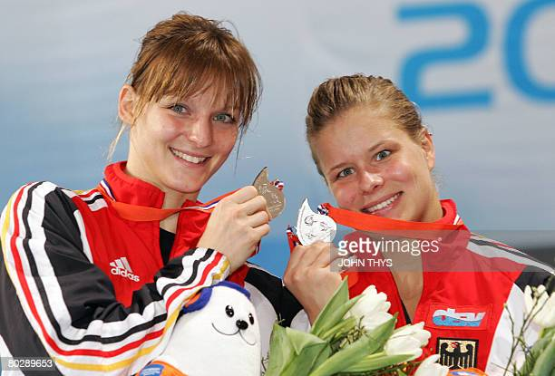 Germany's Heike Fisher and Ditte Kotzian poses with their medals after the women's 3m synchro springboard event of the 29th LEN European swimming...