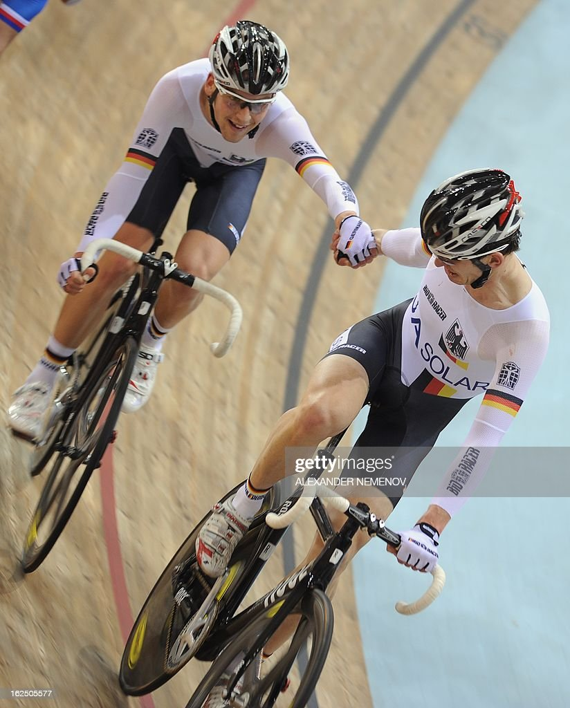 Germany's Henning Bommel and Theo Reinhardt relay on their way to win the bronze medal of the Men's 50km Madison event of the UCI Track Cycling World Championships in Minsk on February 24, 2013. AFP PHOTO / ALEXANDER NEMENOV