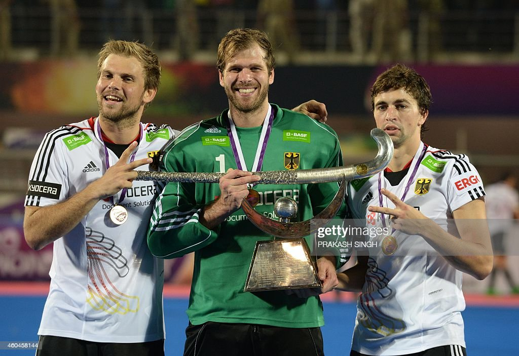 Germany's hockey team captain Moritz Furste goal keeper Nicolas Jacobi and Florian Fuchs pose with trophy during the prize ceremony for Hero Hockey...
