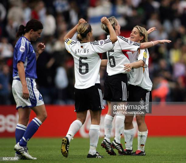 Germany's Inka Grings Conny Pohlers and Britta Carlson celebrate victory over Finland in the Semi Final match of the European Women's Championship...