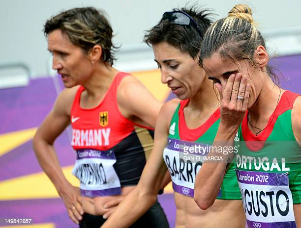 Germany's Irina Mikitenko Portugal's Marisa Barros and Jessica Augusto react after competing in the women's marathon at the London 2012 Olympic Games...