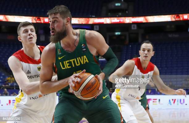 Germany's Isaiah Hartenstein vies with Lithuania's Donatas Motiejunas during the FIBA EuroBasket 2017 championship match between Germany and...