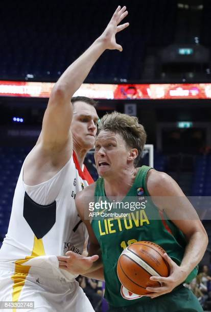 Germany's Isaiah Hartenstein vies with Lithuania's Mindaugas Kuzminskas during the FIBA EuroBasket 2017 championship match between Germany and...