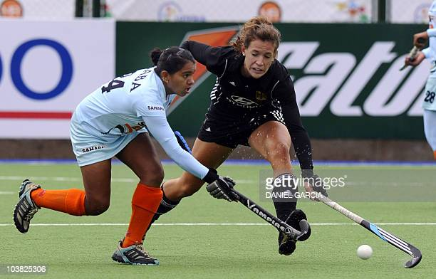Germany's Janne MuellerWieland marks India's Saba Anjum during a field hockey Group A match of the Women's World Cup 2010 in Rosario Argentina on...