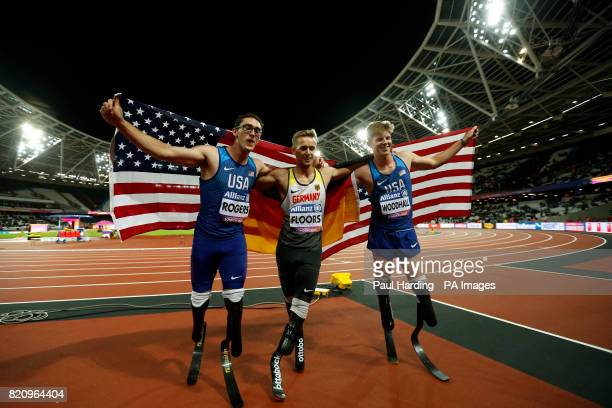 Germany's Johannes Floors celebrates winning the Men's 200m T43 alongside second placed USA's Hunter Woodhall and third placed USA's Nick Rogers...