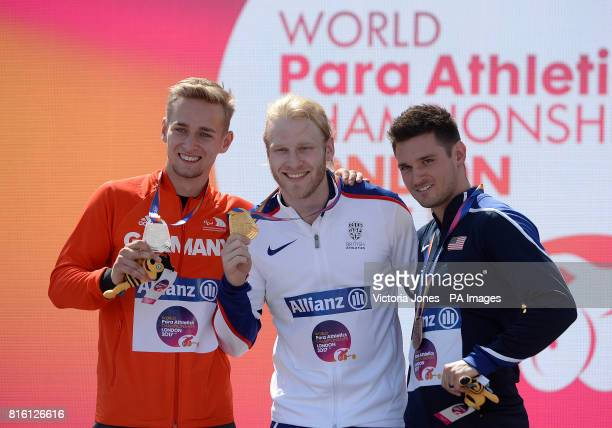 Germany's Johannes Floors Great Britain's Jonnie Peacock and USA's Jarryd Wallace after the Men's 100m T44 Final during day four of the 2017 World...