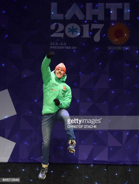 Germany's Johannes Rydzek celebrates during the medals ceremony for men's nordic combined 10 km individual Gundersen event at the FIS Nordic Ski...