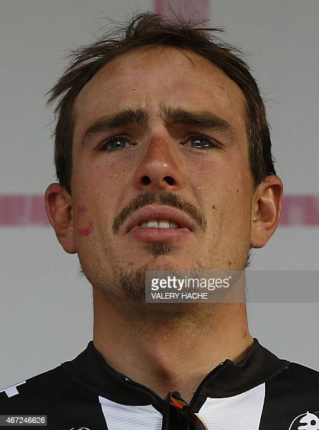 Germany's John Degenkolb of Team Giant Alpecin winner cries on the podium of the 106th Milan San Remo spring classic on March 22 2015 in San Remo...
