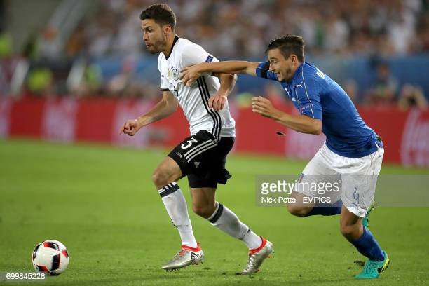 Germany's Jonas Hector and Italy's Matteo Darmian battle for the ball