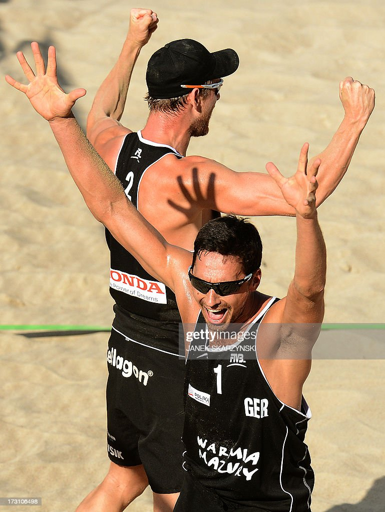 Germany's Jonathan Erdmann (R) and Kay Matysik react after they defeated Brazil's Alison Cerutti and Emanuel Rego (both not pictured) during the third place match of the Beach Volleyball World Championships on July 7, 2013 in Stare Jablonki, Poland.