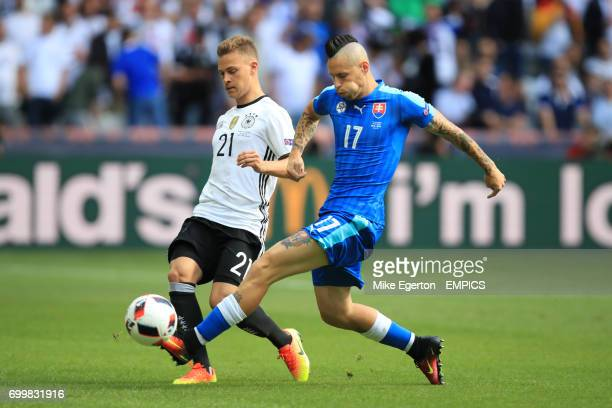 Germany's Joshua Kimmich and Slovakia's Marek Hamsik battle for the ball