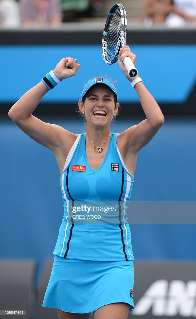 Germany's Julia Goerges celebrates after victory in her women's singles match against China's Zheng Jie on the fifth day of the Australian Open tennis tournament in Melbourne on January 18, 2013. AFP PHOTO/GREG WOOD IMAGE STRICTLY RESTRICTED TO EDITORIAL USE - STRICTLY NO COMMERCIAL USE