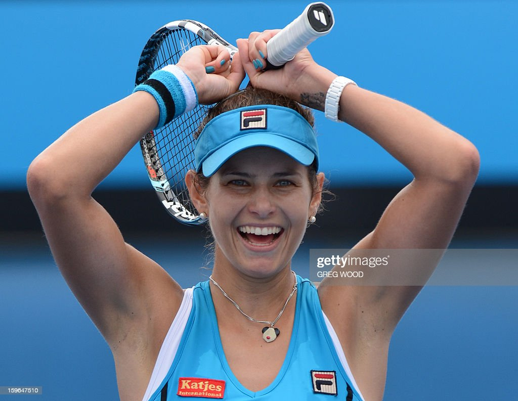 Germany's Julia Goerges celebrates after victory in her women's singles match against China's Zheng Jie on the fifth day of the Australian Open tennis tournament in Melbourne on January 18, 2013.
