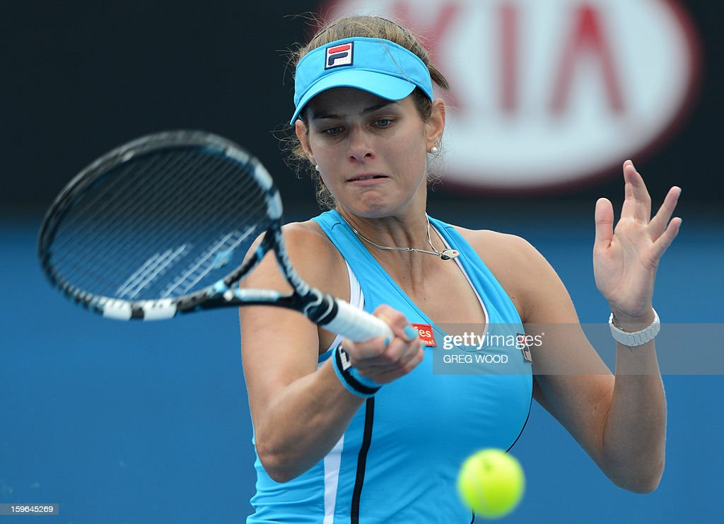 Germany's Julia Goerges plays a return during her women's singles match against China's Zheng Jie on the fifth day of the Australian Open tennis tournament in Melbourne on January 18, 2013.