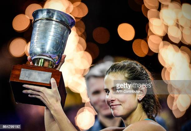 Germany's Julia Goerges poses with the trophy as she celebrates after her victory over Russia's Daria Kasatkina in the Kremlin Cup tennis tournament...