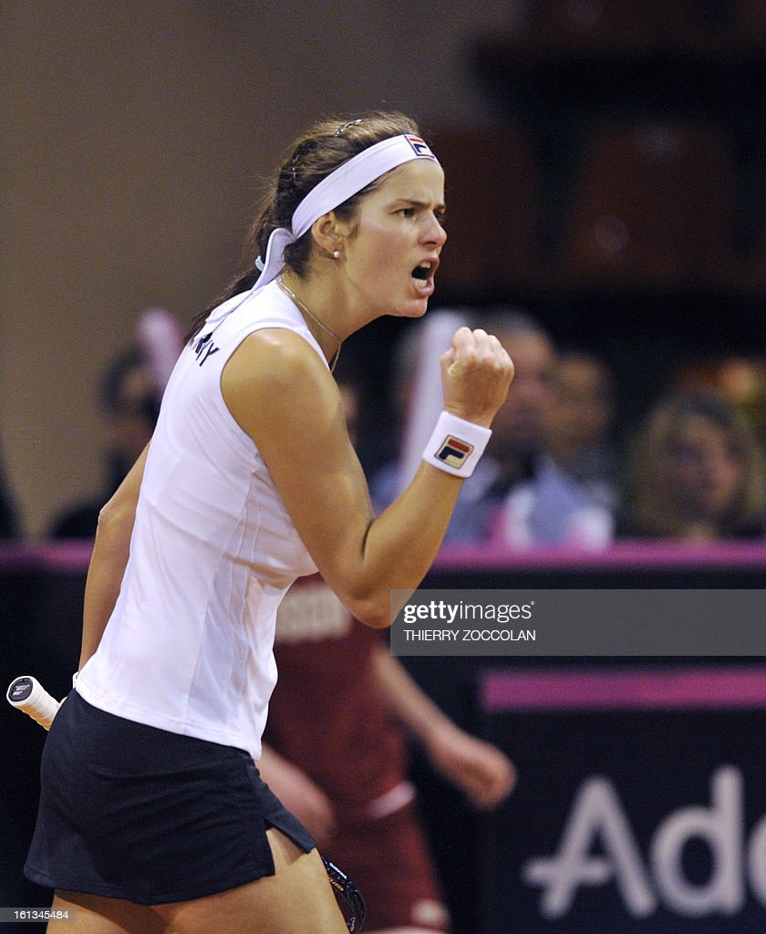 Germany's Julia Goerges reacts after defeating France's Pauline Parmentier on February 10, 2013 during the third match of the Fed Cup 2013 between France and Germany at the Beaublanc courts in Limoges. Germany completed a 3-0 win over France in a Fed Cup World Group II tie today when Julia Goerges defeated Pauline Parmentier 6-4, 6-2. AFP PHOTO / THIERRY ZOCCOLAN