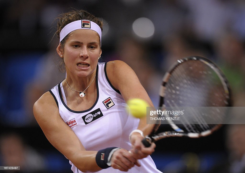 Germany's Julia Goerges returns the ball to Czech's Petra Kvitova in their match of the WTA Porsche Tennis Grand Prix in Stuttgart, southwestern Germany, on April 25, 2013.