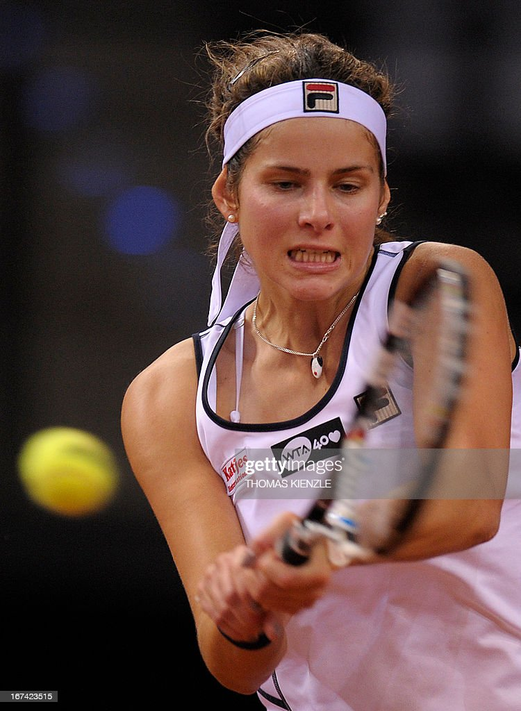 Germany's Julia Goerges returns the ball to Czech's Petra Kvitova in their match of the WTA Porsche Tennis Grand Prix in Stuttgart, southwestern Germany, on April 25, 2013. AFP PHOTO / THOMAS KIENZLE