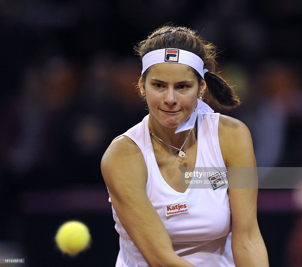 Germany's Julia Goerges returns the ball to France's Pauline Parmentier on February 10, 2013 during the third match of the Fed Cup 2013 between France and Germany at the Beaublanc courts in Limoges. Germany completed a 3-0 win over France in a Fed Cup World Group II tie today when Julia Goerges defeated Pauline Parmentier 6-4, 6-2.