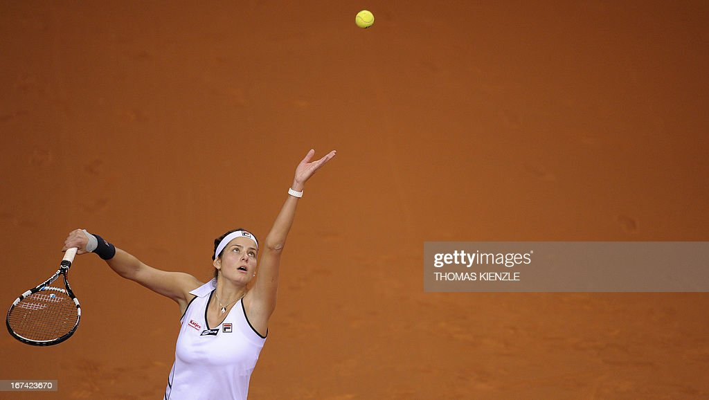 Germany's Julia Goerges serves the ball to Czech's Petra Kvitova in their match of the WTA Porsche Tennis Grand Prix in Stuttgart, southwestern Germany, on April 25, 2013. AFP PHOTO / THOMAS KIENZLE