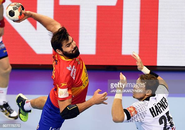 Germany's Kai Hafner vies with Spain's Raul Entrerrios during the final match of the Men's 2016 EHF European Handball Championship between Germany...