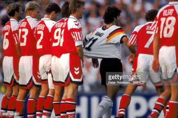 Germany's Karl Heinz Riedle has his shirt pulled by the Danish wall Kim Christofte Henrik Larsen John Sivebaek Fleming Povlsen Lars Olsen John Jensen...
