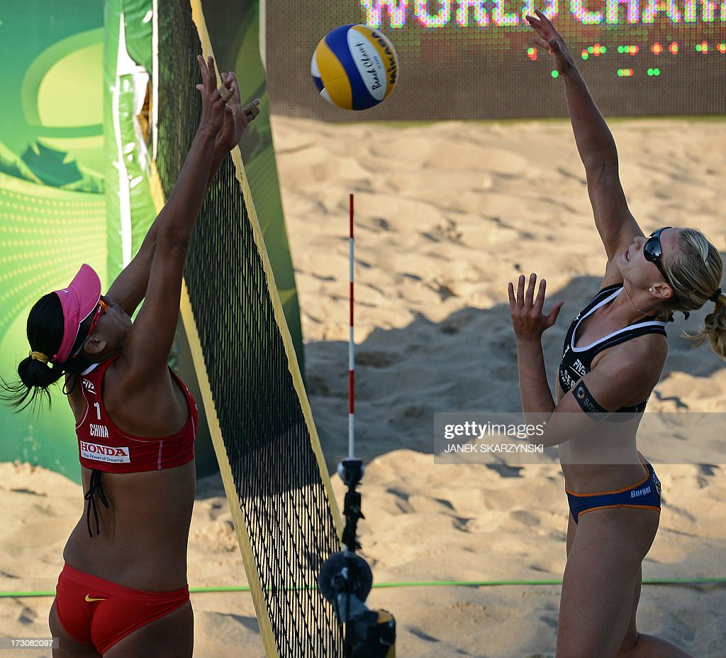 Germany's Karla Borger (L) spikes against China's Zhang Xi (L) in the final match of the Beach Volleyball World Championships on July 6, 2013 in Stare Jablonki, Poland.