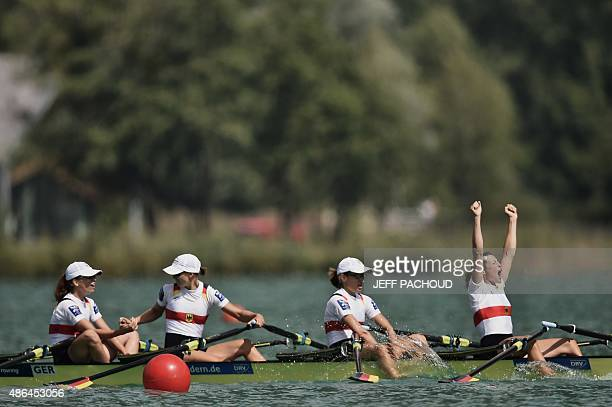 Germany's Katrin Thoma Leonie Pieper Lena Mueller and Anja Noske celebrate as they win the women's lightweight coxless quadruple sculls on September...