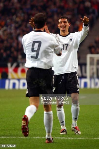 Germany's Kevin Kurayni celebrates with Fredi Bobic