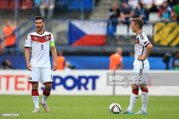 Germany's Kevin Volland and Joshua Kimmich look dejected after seeing their side concede a second goal