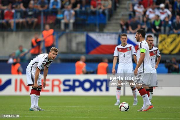 Germany's Kevin Volland and Joshua Kimmich look dejected after seeing their side concede a fourth goal