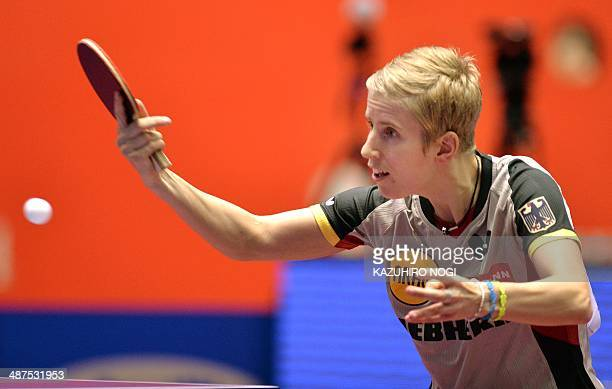 Germany's Kristin Silbereisen returns a shot against Serbia's AnaMaria Erdelji during their match in the women's team championship division group D...