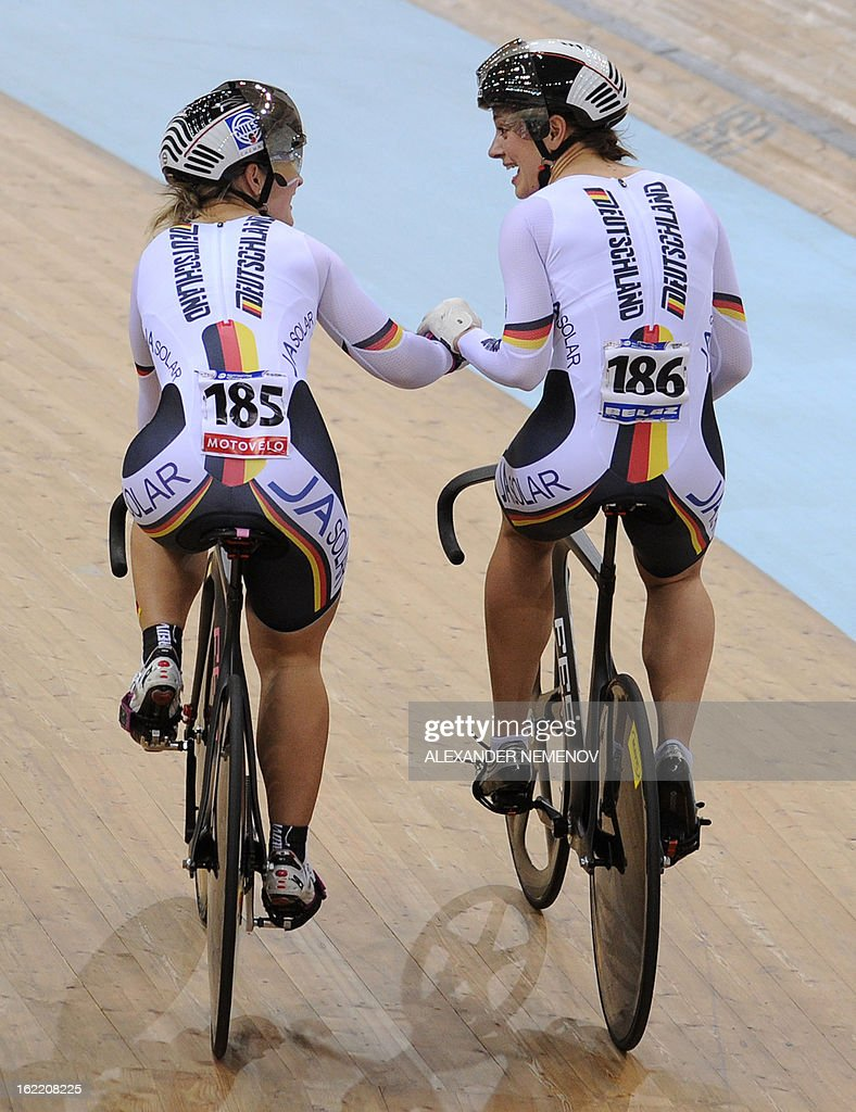 Germany's Kristina Vogel (R) and Mariam Welte celebrate their victory in the womens' team sprint event of the UCI Track Cycling World Championships in Minsk on February 20, 2013.