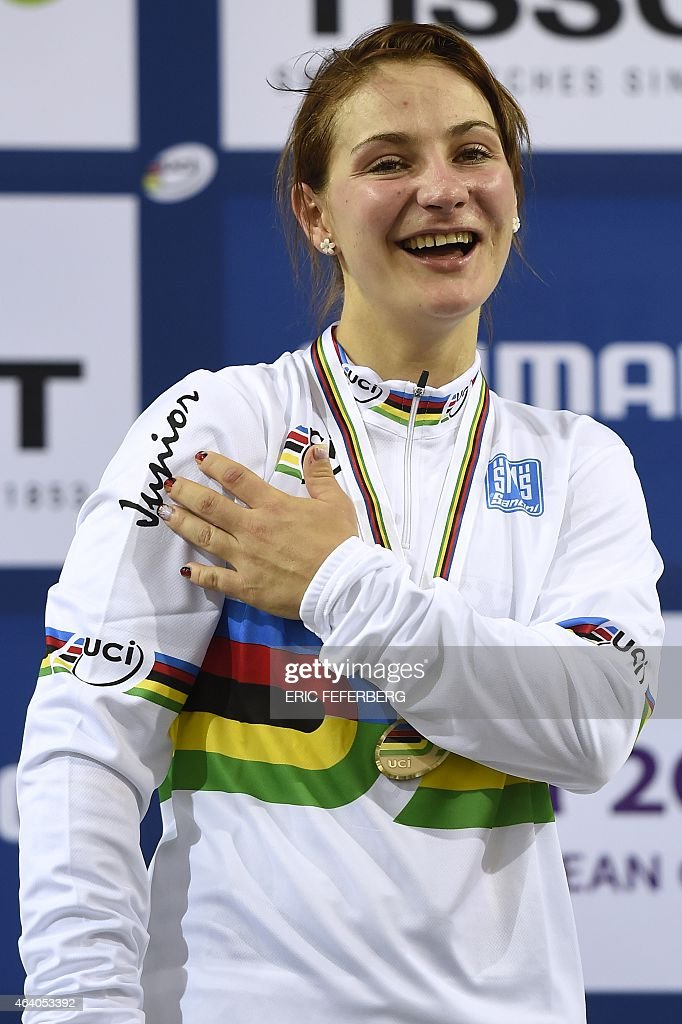Germany's <a gi-track='captionPersonalityLinkClicked' href=/galleries/search?phrase=Kristina+Vogel&family=editorial&specificpeople=5779542 ng-click='$event.stopPropagation()'>Kristina Vogel</a> indicates the word 'Junior' on her UCI jersey as she celebrates on the podium after winning the Women's Sprint at the UCI Track Cycling World Championships in Saint-Quentin-en-Yvelines, near Paris, on February 21, 2015.