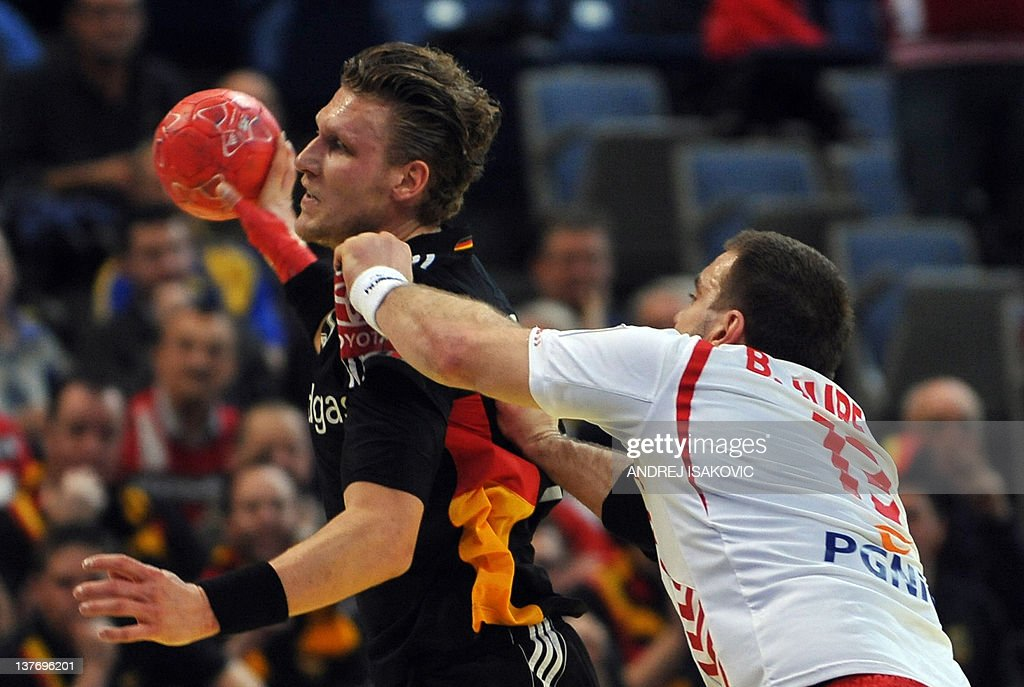 Germany's Lars Kaufmann (L) vies with Poland's Bartosz Jurecki (R) during their Men's EHF Euro 2012 Handball Championship match Poland vs Germany on January 25, 2012, at the Belgrade Arena. AFP PHOTO / ANDREJ ISAKOVIC