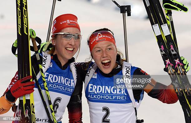 Germany's Laura Dahlmeier and Franziska Preuss react after finishing respectively second and third in the women's 10 km pursuit event of the IBU...