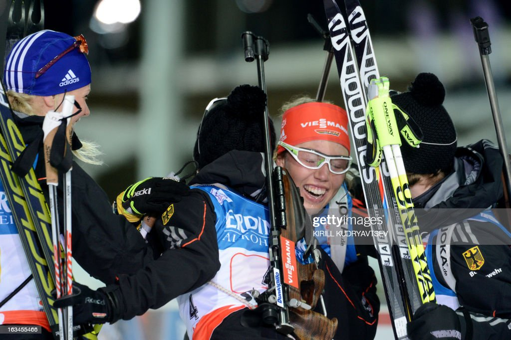 Germany's Laura Dahlmeier (2nd R) celebrates with her teammates after winning the Women's 4x6 km Relay during the IBU World Cup Biathlon at Laura Cross Country and Biathlon Center in the Russian Black Sea resort of Sochi on March 10, 2013. Germany took the first place ahead of Ukraine and Norway. AFP PHOTO / KIRILL KUDRYAVTSEV