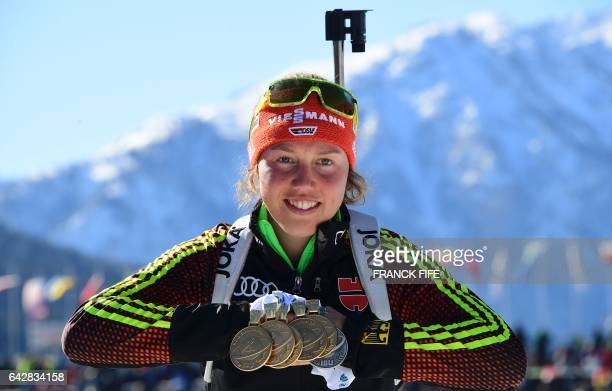 Germany's Laura Dahlmeier poses with her six medals after winning the 2017 IBU World Championships Biathlon Women's 125 km Mass start race in...