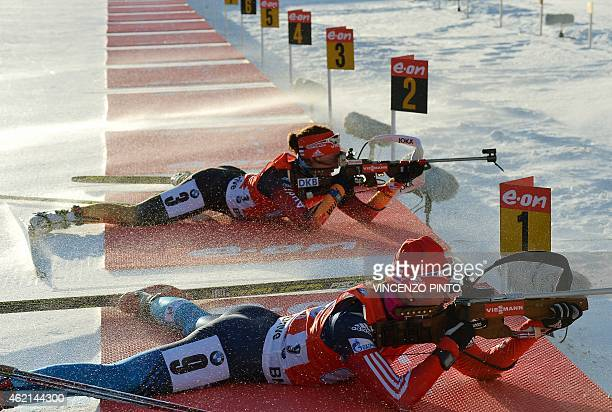 Germany's Laura Dahlmeier shoots next to Russian Ekaterina Glazyrina during the Women's 4x6 km relay race of the IBU Biathlon World Cup on January 25...