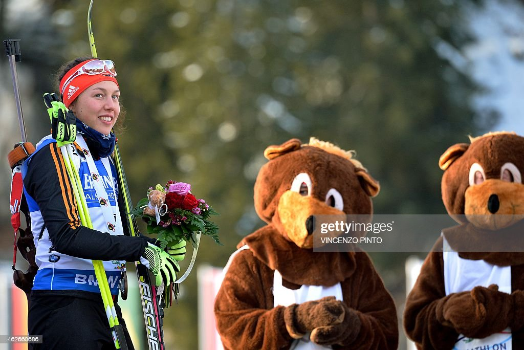Germany's <a gi-track='captionPersonalityLinkClicked' href=/galleries/search?phrase=Laura+Dahlmeier&family=editorial&specificpeople=10284324 ng-click='$event.stopPropagation()'>Laura Dahlmeier</a> smiles on the podium of the women's 7,5 km Sprint race of the IBU Biathlon World Cup on January 23, 2015 in the Italian Alpine resort of Antholz-Anterselva. Belarus' Darya Domracheva won the race ahead of Finland's Kaiser Makarainen and Germany's <a gi-track='captionPersonalityLinkClicked' href=/galleries/search?phrase=Laura+Dahlmeier&family=editorial&specificpeople=10284324 ng-click='$event.stopPropagation()'>Laura Dahlmeier</a>. AFP PHOTO / VINCENZO PINTO