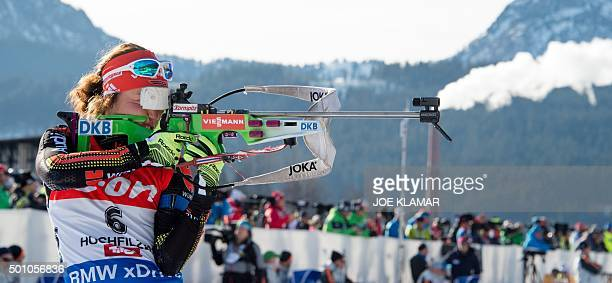 Germany's Laura Dahlmeier takes her shooting to win the women's 10 km pursuit event during IBU World Cup in biathlon in Hochfilzen on December 12...